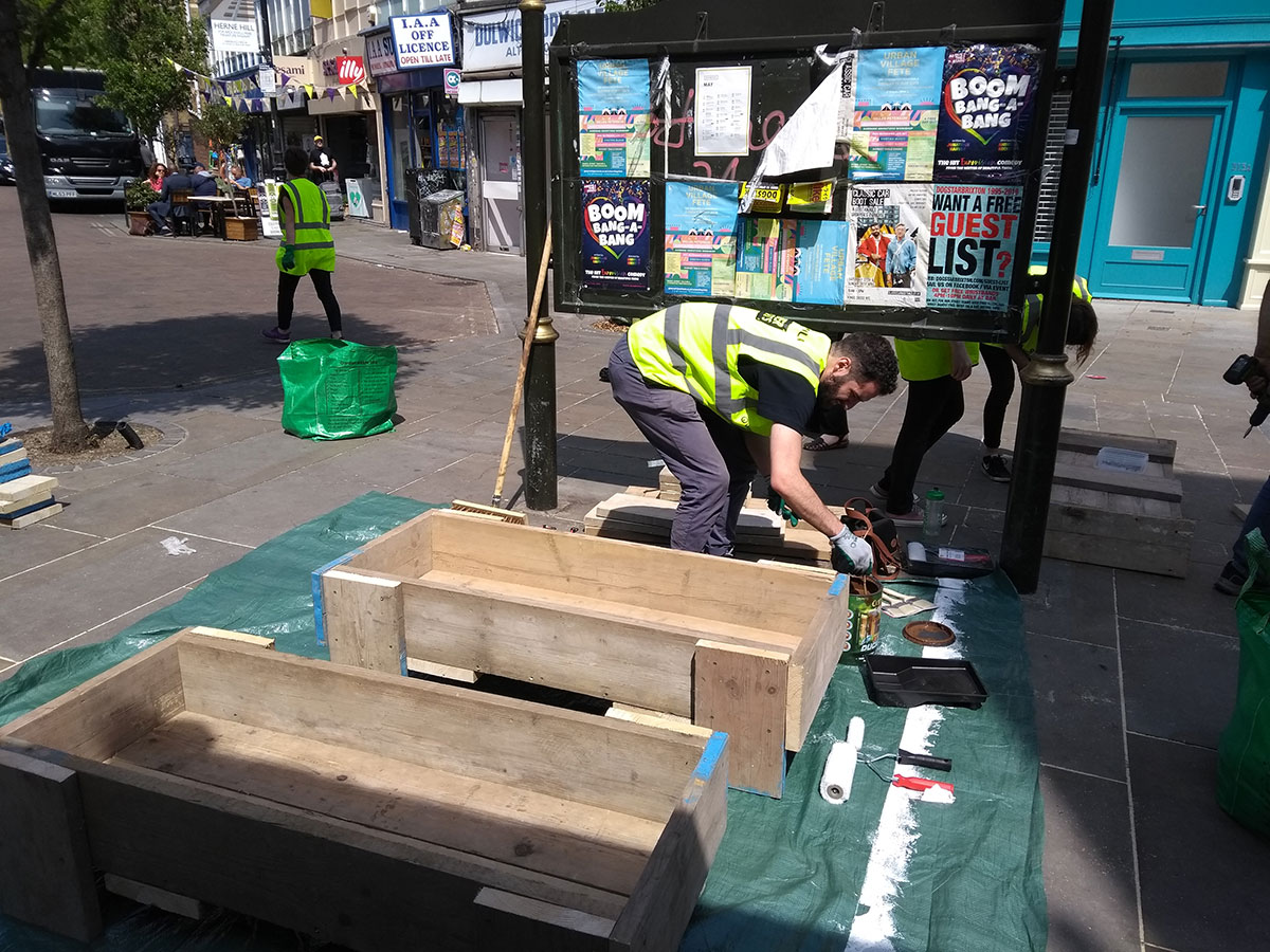 Volunteers making new planters in Station Square, Herne Hill