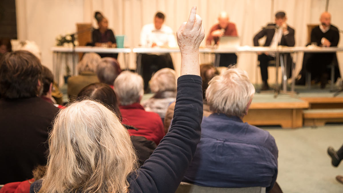 Herne Hill Forum - a meeting in progress with someone raising their hand