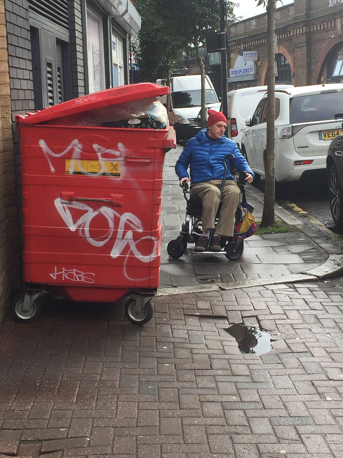 Herne Hill Forum Bin Go project - George Hornby in wheelchair struggling to get passed the commercial bins