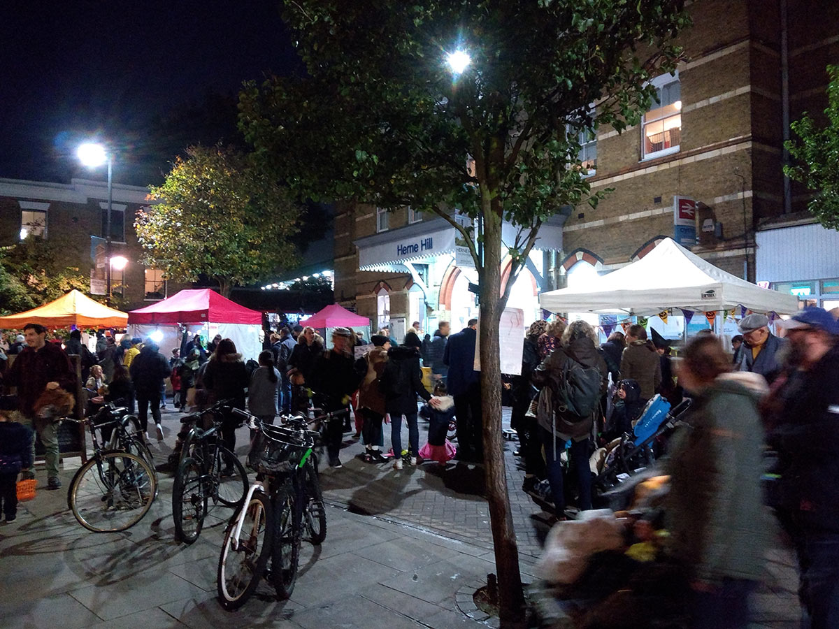 Herne Hill halloween 2019 - a crowd outside the train station