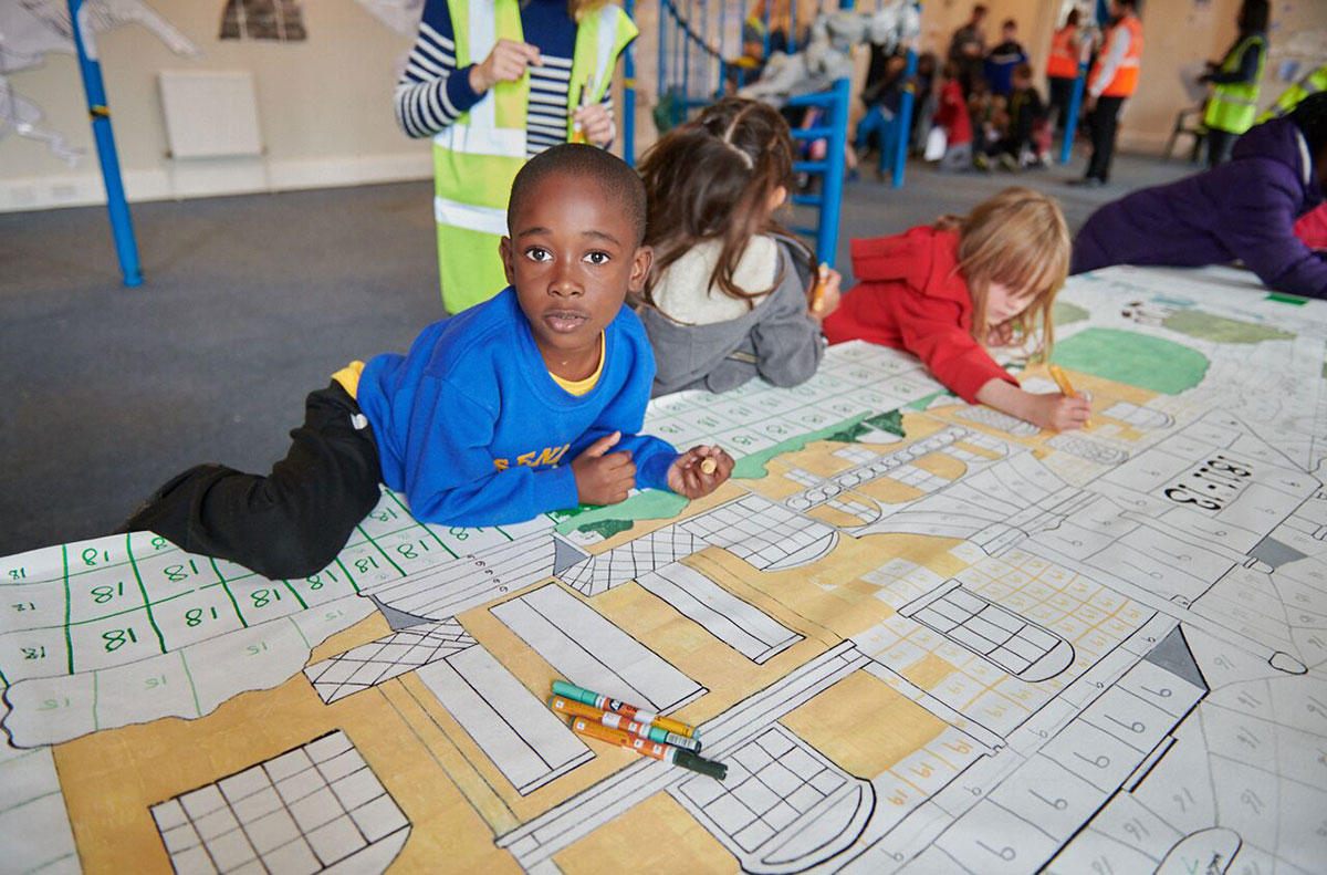 Herne Hill Mural being coloured in by young children