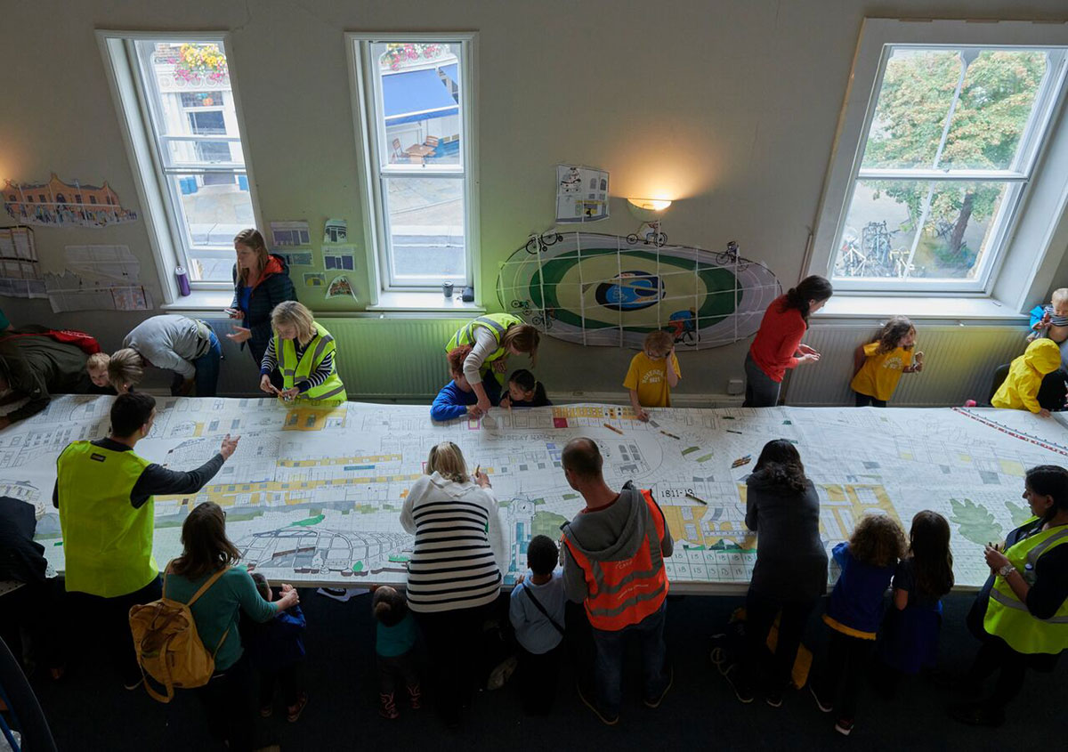 Herne Hill mural being coloured in by the community in Station Hall