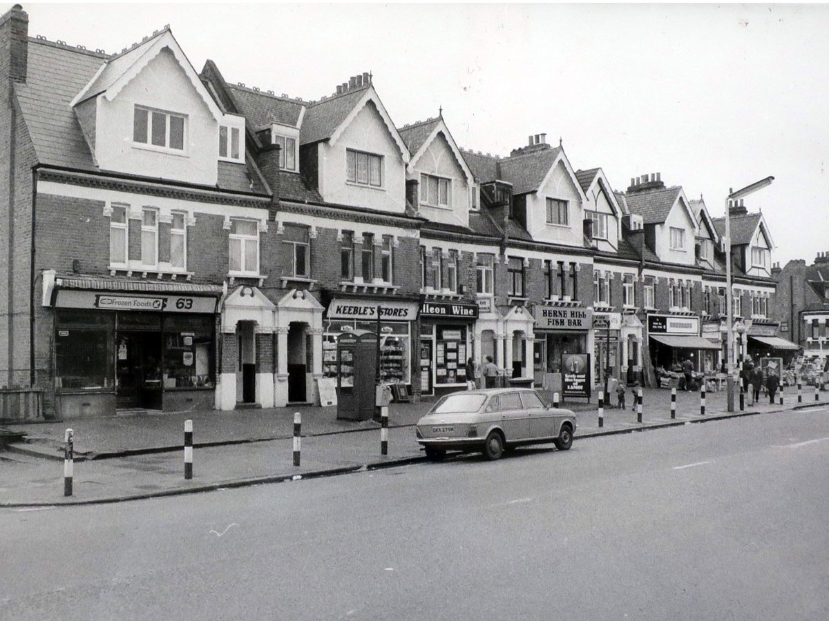 A black and white vintage photo of the parade of shops on Herne Hill including the Fish bar
