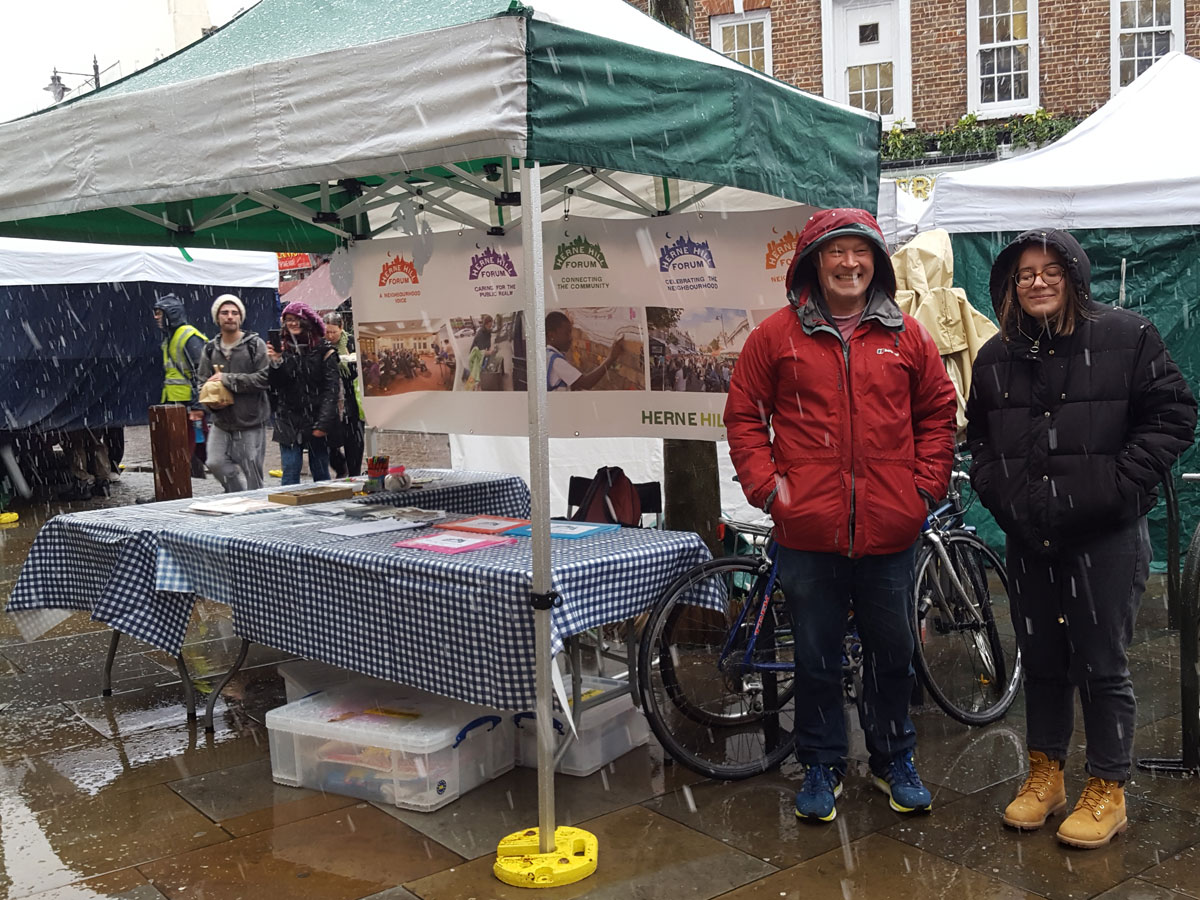 Heavy rain at the Herne Hill Forum community tent at the market in Station Square