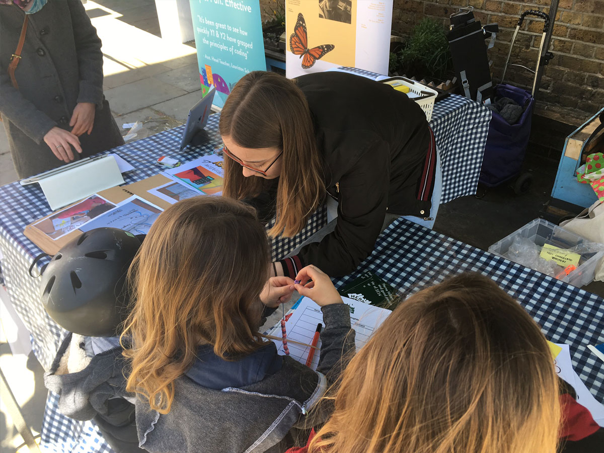 Young people help run the Herne Hill community tent at the market