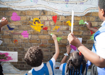 St Judes school children painting Brockwell Passage in Herne Hill