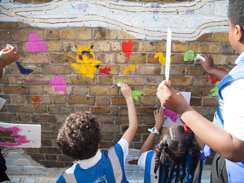 St Judes school children painting Brockwell Passage in Herne Hill